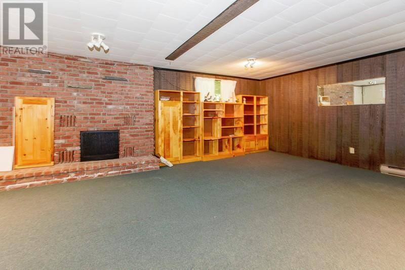 1493 Highway 96 East - Basement living room